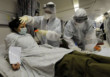 An Israeli soldier participates in a simulated bioterrorism drill at Hadassah Hospital in Jerusalem