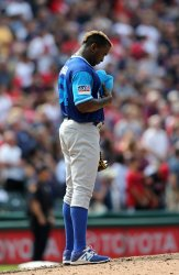 Royals Garcia stands during the playing of God Bless America against the Indians