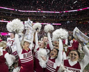 The Alabama Crimson Tide cheerleaders celebrate their 26-23 victory over the Georgia Bulldogs in the National Championship