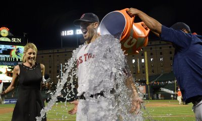 Boston pitcher Rick Porcello is dunked with ice water after throwing a 5-2 complete game win on 89 pitches against Baltimore