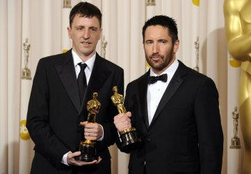 Achievement in Music (Original Score) winners Trent Reznor and Atticus Ross at the 83rd annual Academy Awards in Hollywood
