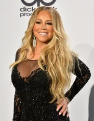Mariah Carey appears backstage at the 46th annual American Music Awards in Los Angeles