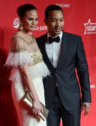 John Legend and Christine Teigen arrive at 2013 MusiCares Person of the Year gala in Los Angeles
