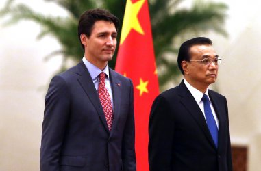 Trudeau and Li stand next to each other during a welcoming ceremony in Beijing, China