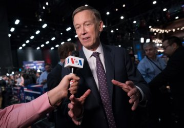 John Hickenlooper speaks to the media at the Democratic Presidential Primary Debate in Miami