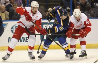 St. Louis Blues Vladimir Tarasenko is tied up by Detroit Red Wings Danny DeKeyser and Luke Glendening