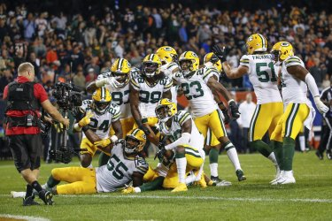 Packers Adrian Amos celebrates with teammates in Chicago