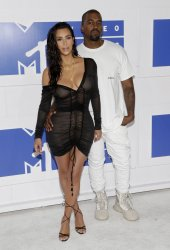 Kim Kardashian West and Kanye West arrive at the 2016 MTV Video Music Awards