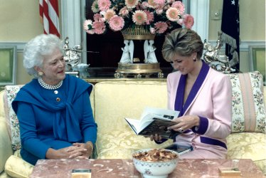 First Lady Barbara Bush presents a book to Princess Diana