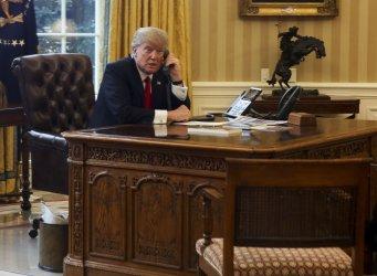 President Donald Trump speaks with the King of Saudi Arabia