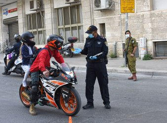 An Israeli Police Wears A Mask And Gloves In Jerusalem