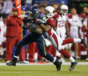 Seattle Seahawks beat the Arizona Cardinals 58-0 in Seattle.