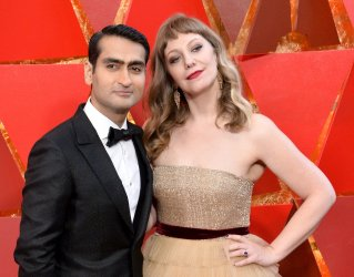 Kumail Nanjiani and Emily V. Gordon arrive for the 90th annual Academy Awards in Hollywood