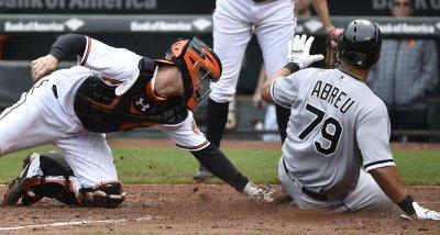 Orioles catcher Caleb Joseph tags out White Sox runner Jose Abreu