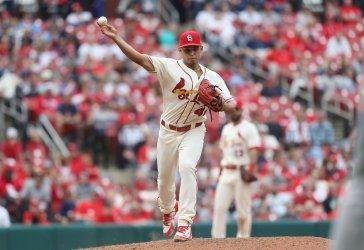 St. Louis Cardinals pitcher Jordan Hicks makes pickoff throw
