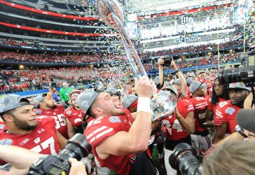 Wisconsin Badgers T. J. Watt celebrates the Badgers 24-16 victory over the Western Michigan Broncos