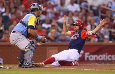 St. Louis Cardinals Stephen Piscotty scores on sacrifice fly ball .