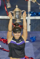 Bianca Andreescu (CAN) holds the trophy at the US Open