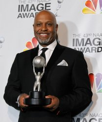 Actor James Pickens, Jr. holds his award for Outstanding Supporting Actor in a Drama Series for 'Grey's Anatomy' in the press room the 43rd NAACP Image Awards in Los Angeles