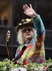 Arlo Guthrie rides down the parade route on a float at the Macy's 84th Annual Thanksgiving Day Parade in New York