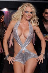Pamela Anderson steps out on to the runway in the A*MUSE by Richie Rich fall fashion show at Mercedes-Benz Fashion Week in New York