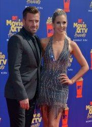 Jason Wahler and Ashley Slack attend the MTV Movie & TV Awards in Santa Monica, California