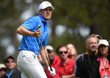 Jordan Spieth reacts after a tee shot at the Masters