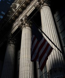 United States Flags hang outside of the NYSE