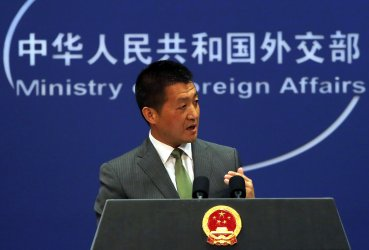 Chinese foreign ministry spokesman Lu Kang holds a press conference in Beijing