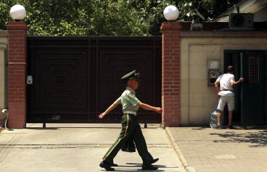 Chinese soldiers patrol near North Korea's embassy in Beijing