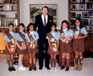 Former President Ronald Reagan poses with Girl Scouts