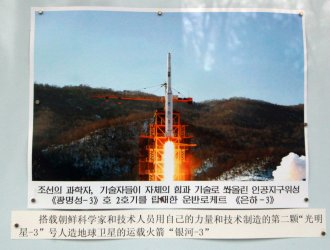 A photo of a long-range rocket is displayed at  the North Korean embassy in Beijing