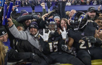 Baltimore Ravens wide receiver Marquise Brown and Mark Ingram Celebrates with fans.