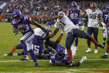 Vikings Dalvin Cook scores a touchdown in Chicago