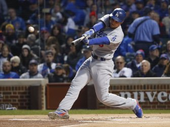 Los Angeles Dodgers shortstop Corey Seager hits a double in Chicago