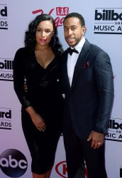 Host Ludacris (R) and Eudoxie Mbouguiengue attend the Billboard Music Awards in Las Vegas