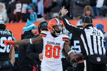Browns Landry talks to down judge during game against Panthers