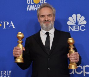 Sam Mendes wins an award at the 77th Golden Globe Awards in Beverly Hills