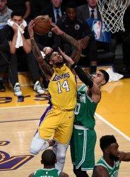 Lakers forward Brandon Ingram (14) shoots over Celtics Jayson Tatum (0) at Staples Center