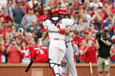 Los Angeles Angles Albert Pujols hugs St. Louis Cardinals catcher Yadier Molina