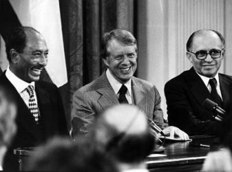 Pres. Carter, Pres. Sadat and Israeli PM Begin Sign Peace Agreements