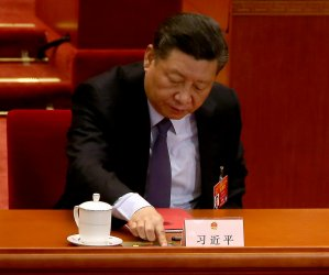 Xi votes during the NPC in Beijing, China