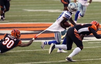 Cowboys CeeDee Lamb fights to break free from Bengals Jessie Bates