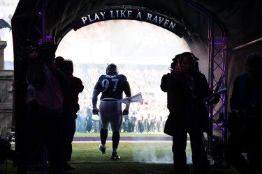 Ravens' Michael Pierce takes the field