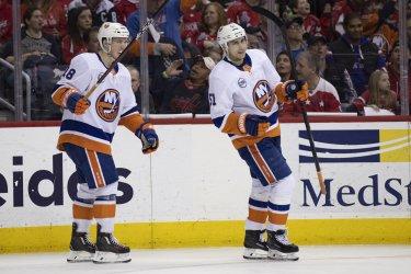 New York Islanders left wing Anthony Beauvillier celebrates with Islanders center Valtteri Filppula