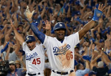 Dodgers Puig and Woodward celebrate game 2 win in the NLCS