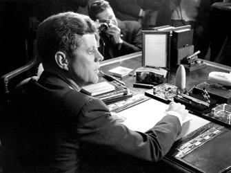 PRESIDENT JOHN F. KENNEDY SIGNING BILL BLOCKADING CUBA