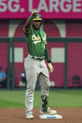 Athletics Starling Marte Waves at His Dugout