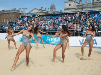 Cheerleaders entertain the crowd at Beach Volleyball