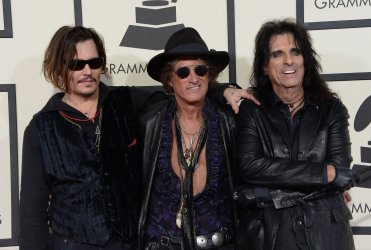 Johnny Depp, Joe Perry and Alice Cooper arrive for the 58th annual Grammy Awards in Los Angeles